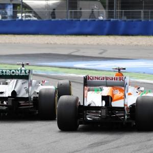 Formula One World Championship 2012, Round 10, German Grand Prix, Hockenheim, Germany, Sunday 22 July 2012 - Nico Hulkenberg (GER) Sahara Force India F1 VJM05 and Michael Schumacher (GER) Mercedes AMG F1 W03 battle for position.
