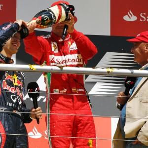 Formula One World Championship 2012, Round 10, German Grand Prix, Hockenheim, Germany, Sunday 22 July 2012 - The podium (L to R): second placed Sebastian Vettel (GER) Red Bull Racing with race winner Fernando Alonso (ESP) Ferrari and Niki Lauda (AUT).