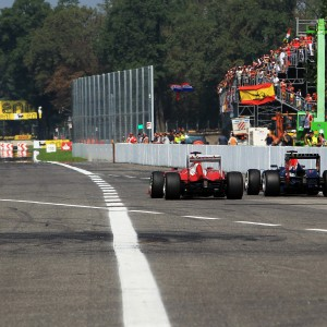 Formula One World Championship 2012, Round 13, Italian Grand Prix, Monza, Italy, Sunday 9 September 2012 - Fernando Alonso (ESP) Ferrari F2012 and Sebastian Vettel (GER) Red Bull Racing RB8 battle for position leaving the pits.