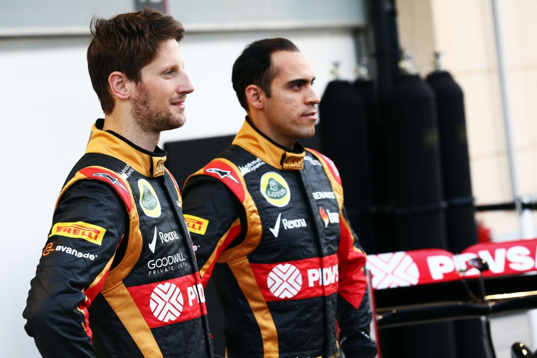 Formula One Winter Testing, Bahrain International Circuit, Sakhir, Bahrain, Thursday 20 February 2014 - L to R): Romain Grosjean (FRA) Lotus F1 Team with team mate Pastor Maldonado (VEN) Lotus F1 Team Lotus as the F1 E22 is officially unveiled.