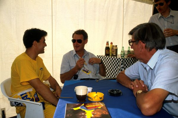 Tyrrell desiger Harvey Postlethwaite (Centre) and team owner Ken Tyrrell (Right) talk with Jean Alesi (FRA) (Left) who replaced Michele Alboreto at Tyrrell and was a stunning fourth in his first F1 race. French Grand Prix, Paul Ricard, 9 July 1989.