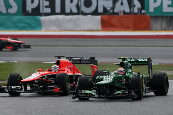 Giedo van der Garde (NED) Caterham CT03 and Jules Bianchi (FRA) Marussia F1 Team MR02. Formula One World Championship, Rd2, Malaysian Grand Prix, Race, Sepang, Malaysia, Sunday 24 March 2013.