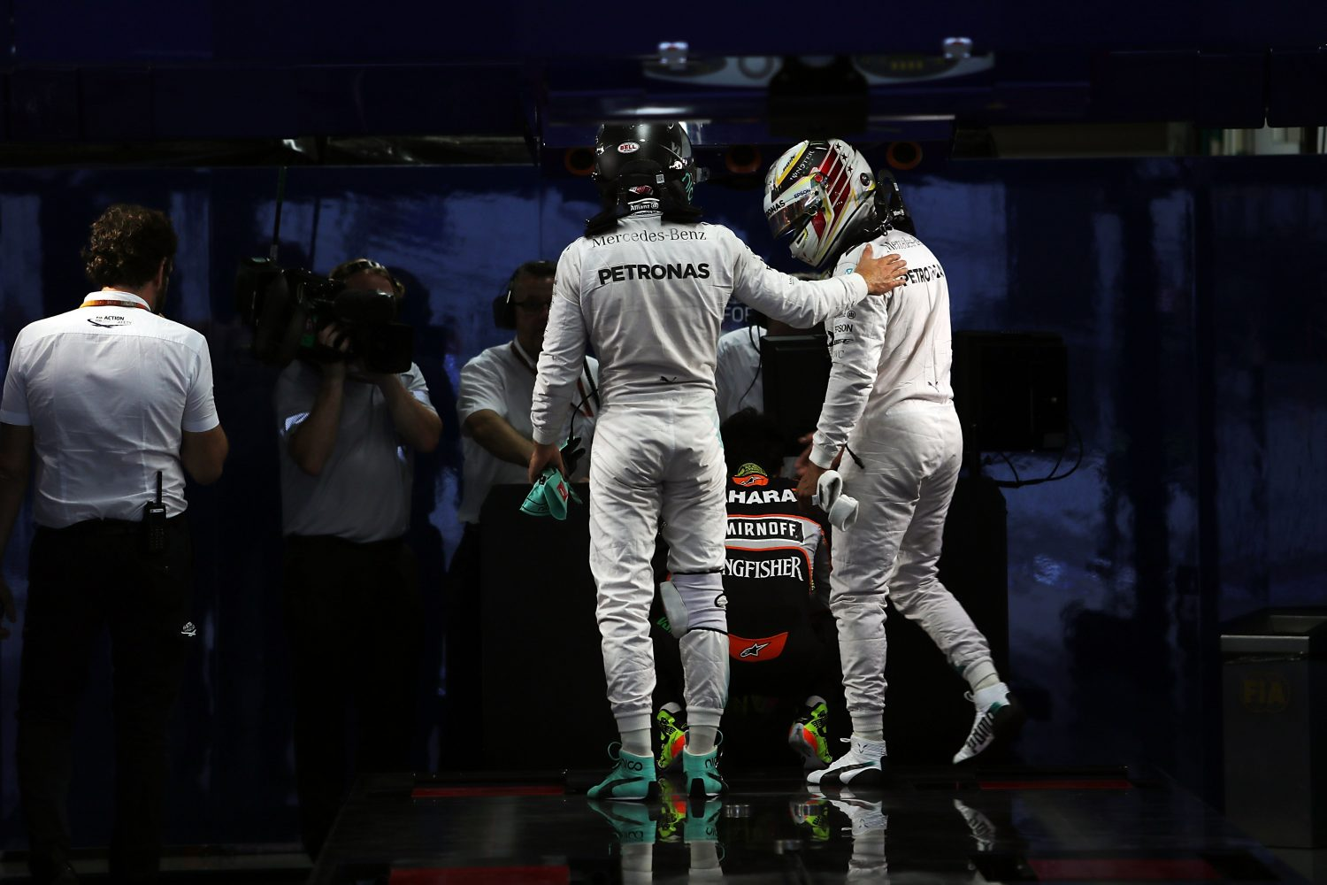 Formula One World Championship 2016, Round 17, Japanese Grand Prix, Suzuka, Japan, Saturday 8 October 2016 - L to R): Nico Rosberg (GER) Mercedes AMG F1 and team mate Lewis Hamilton (GBR) Mercedes AMG F1 in parc ferme.