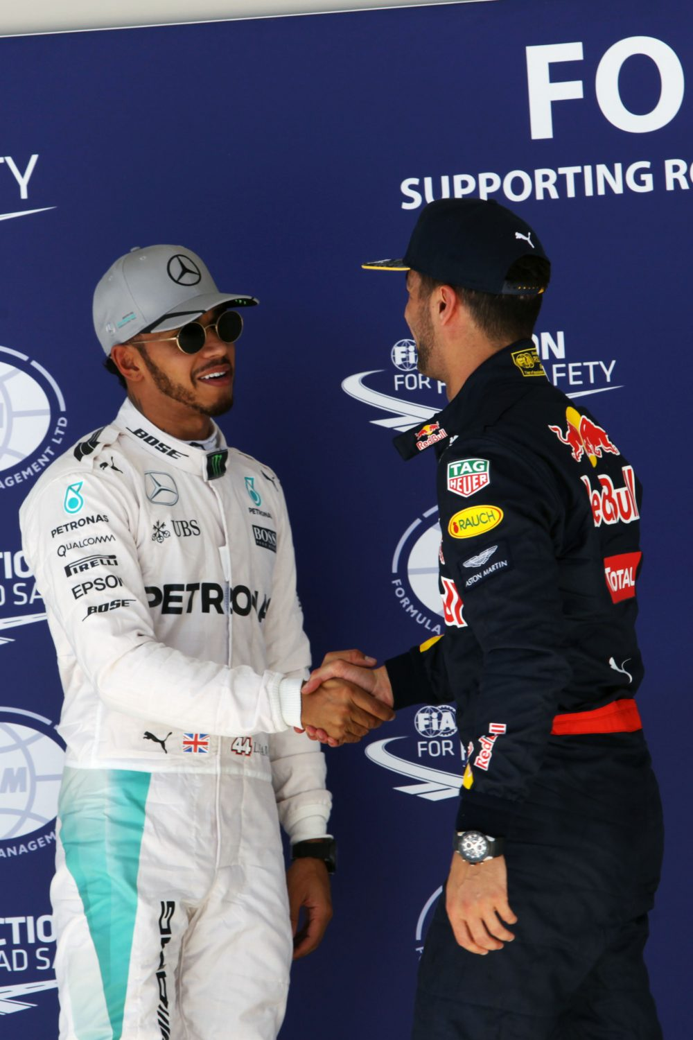 Formula One World Championship 2016, Round 18, United States Grand Prix, Austin, United States, Saturday 22 October 2016 - L to R): Lewis Hamilton (GBR) Mercedes AMG F1 celebrates his pole position in parc ferme with third placed Daniel Ricciardo (AUS) Red Bull Racing.
