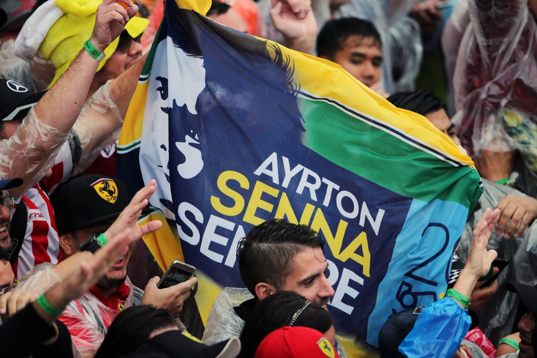 Formula One World Championship 2016, Round 20, Brazilian Grand Prix, Sao Paulo, Brazil, Sunday 13 November 2016 - A Ayrton Senna banner with fans at the podium.