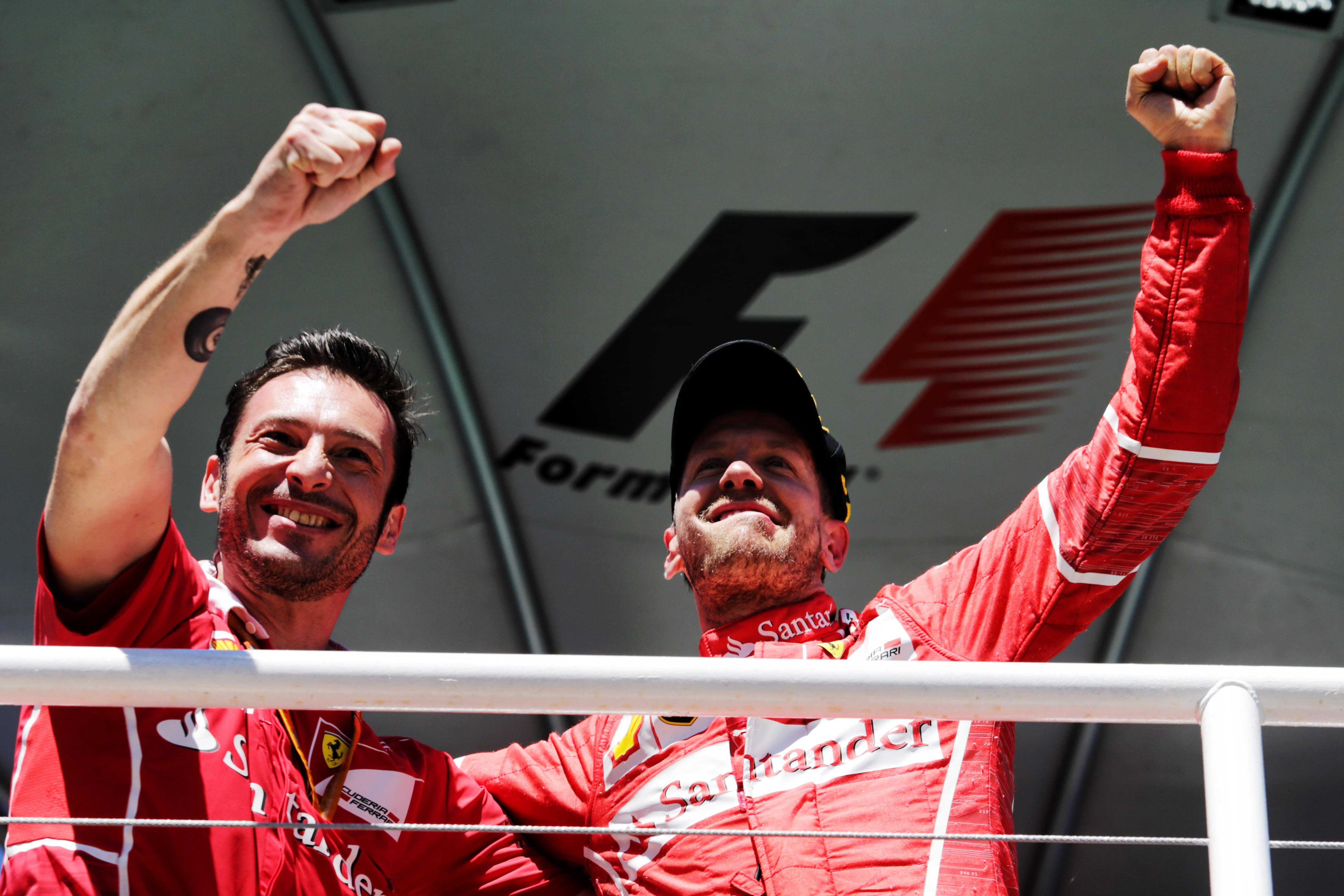 Formula One World Championship 2017, Round 19, Brazilian Grand Prix, Sao Paulo, Brazil, Sunday 12 November 2017 – Race winner Sebastian Vettel (GER) Ferrari celebrates on the podium with Giuseppe Vietina (ITA) Ferrari.